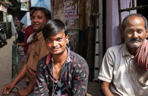 Workers in Old Delhi taking a break from work